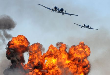 airborne vehicle: Two jetfighters in a ground attack with fire and smoke