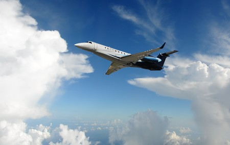 Luxury private jet high up in the clouds