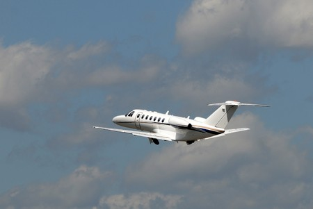 Luury private jet departing on a business trip