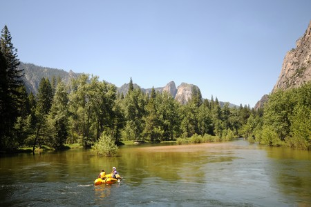 adventurers: Rafting on a slow river in the Sierra Nevada, California