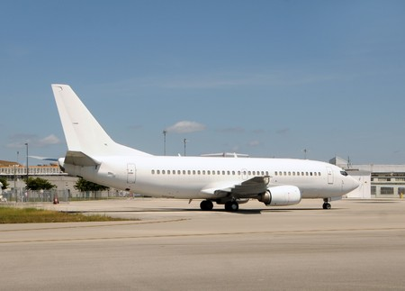 unmarked: Unmarked white passenger jet airplane side view