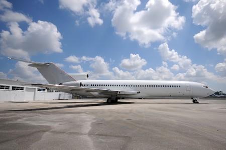 Passenger jet airplane ona tarmac side view Stock Photo - 7504310