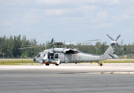US Navy helicopter stopever on the ground Stock Photo