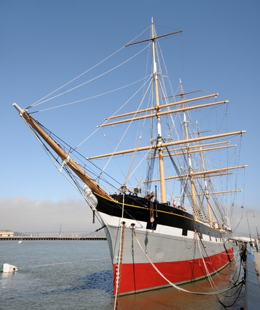 tall ship: Old tall ship tied down in port