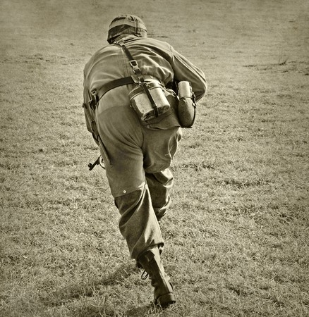 battleground: World War II era soldier on a battlefield Stock Photo