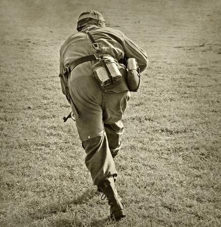wartime: World War II era soldier on a battlefield Stock Photo