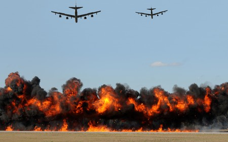 Heavy bombers shooting tagets on the ground Stock Photo