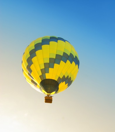 Colorful hot air balloon floating in early morning photo