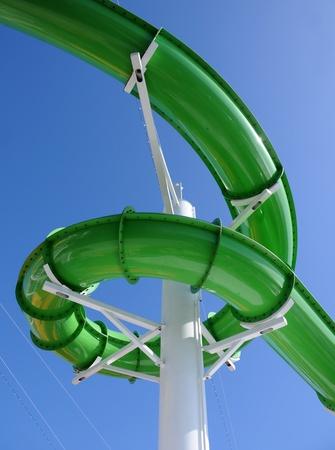 WATER SLIDE: Green water slide at aquatic amusement park