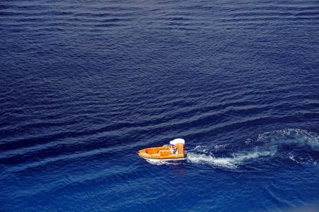 Boat conducting rescue operation at sea 版權商用圖片