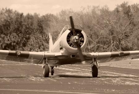 World War II era propeller airplane on the ground photo