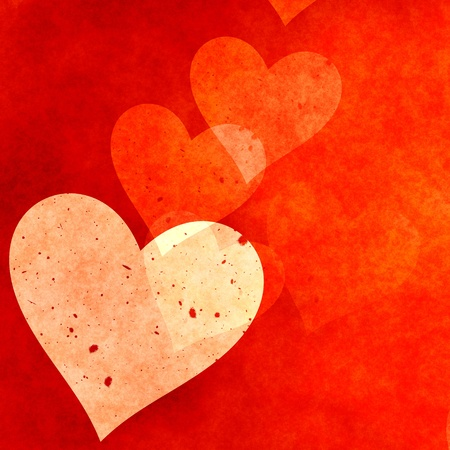 Scattered red hearts for a grunge background photo