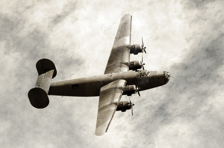 World War II era heavy American bomber on old scratched photo