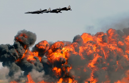 Jetfighters sropping powerful bombing of gorund targets photo