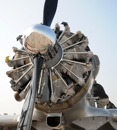 polished: Retro propeller airplane nose and radial engine view