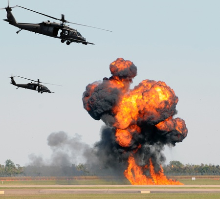 bombardment: Helicopters mounting a ground attack with explosions and smoke