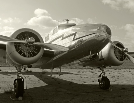 World war II era transport airplane parked on the ground 에디토리얼