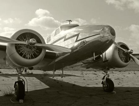 World war II era transport airplane parked on the ground
