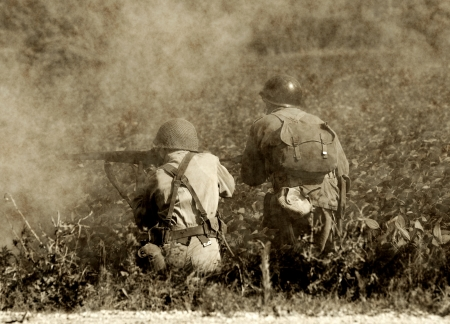 world wars: Two soldiers ina  World War II era battlefield Editorial