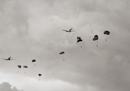 World War II era airplanes dropping paratroopers