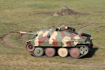 world war two: World War II era German tank in a field