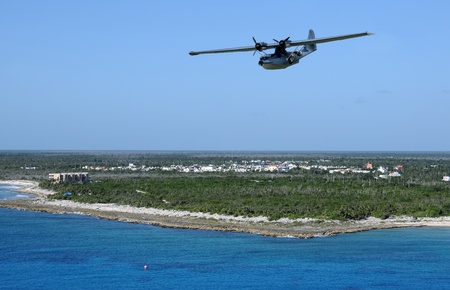 Seaplane flying over exotic Caribbean island
