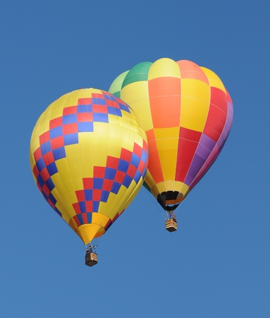 hot air balloons: Two colorful hot air balloons floating next to each other