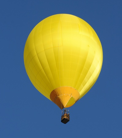 colrful: Yellow hot air balloon floating overhead