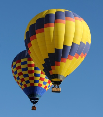 hot air balloons: Two colorful hot air balloons in flight