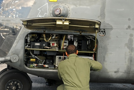 Engineer maintaining a heavy marine helicopter