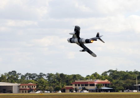 Old military jet airplane taking off Editorial