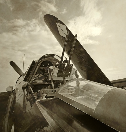 World War II era fighter plane with folded wings photo