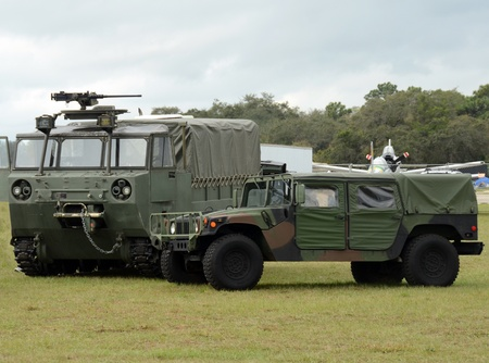 Army all terrain vehicles in camouflage colors