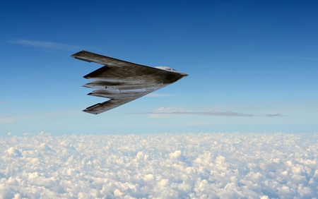 Modern stealth bomber flying at high altitude Editöryel
