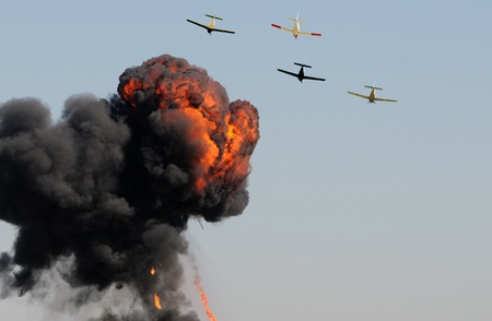bombardment: Old airplanes in a bombing run with smoke and fire Editorial