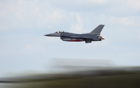 Military jet airplane at high speed with motion blur