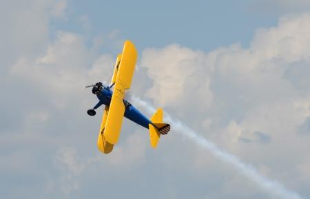 World War Ii era biplane in yellow color