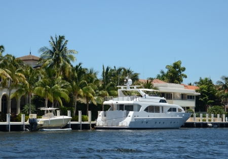 waterway: Luxury yacht in front of mansion