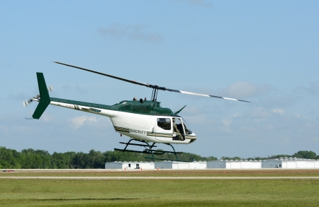Sheriff police department helicopter departing on patrol