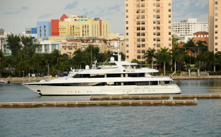 Expensive yacht leaving port on a journay Stock Photo