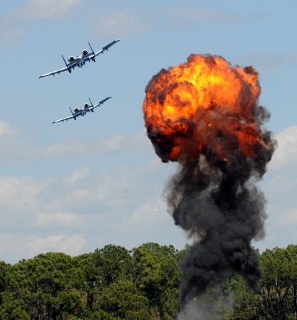 bombardment: Modern military jetfighters performing targed bomb raid Editorial