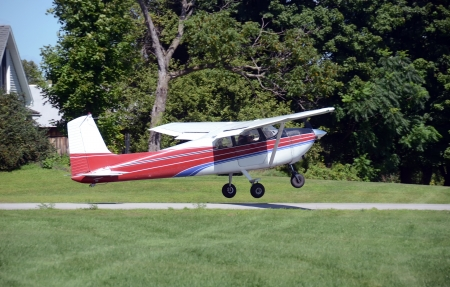 Light private airplane taking off side view Editorial