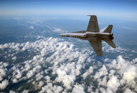 modern fighter: Modern Navy fighter jet flying high in the sky Editorial