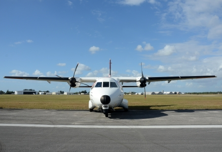 turboprop: Modern turboprop airplane on the ground front view Stock Photo