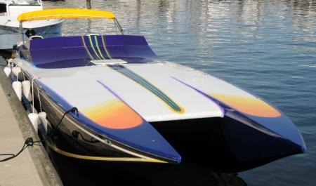speedboat: Modern speed boat docked in a marina