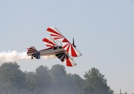 Retro biplane aircraft taking off