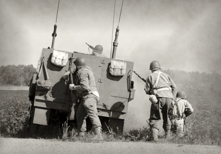battling: Soldiers in World War II era battle