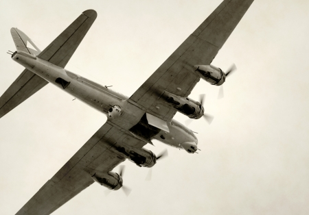 World War II era bomber flying with bomb bay open