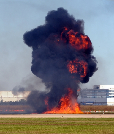 tnt: Giant outdoor explosion with flames and smoke Stock Photo