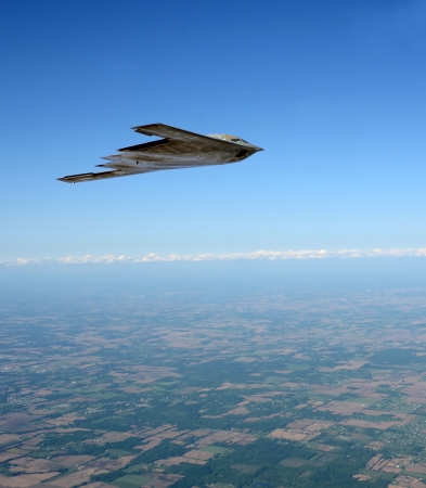State of the art stealth bomber flying at high altitude Stock Photo